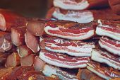 image of pork belly  - Cured Bacon Stack Smoked and Preserved Pork Meat is Considered a Delicacy Food in Some Cultures selective focus - JPG