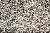 stock photo of bump  - A simple yet strong brick wall with speckles and bumps of texture - JPG