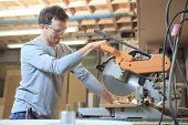 foto of carpenter  - A Carpenter working hard at the shop  - JPG
