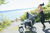 picture of buggy  - A Young mother jogging with a baby buggy - JPG