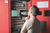 image of adjustable-spanner  - machinist worker technicians at work adjusting lift with spanners in elevator hoistway - JPG