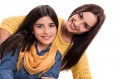 foto of little sister  - Woman and little girl hugging each other  - JPG