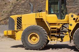 foto of bulldozers  - bulldozer in action in a big quarry - JPG
