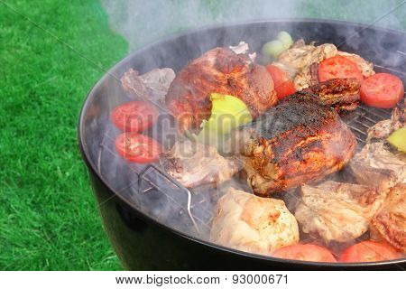 Meat And Vegetables Mix On The Hot Bbq Grill