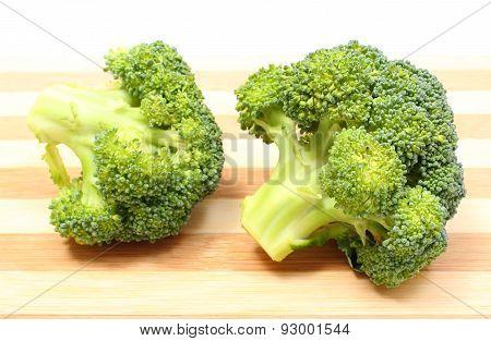 Portion Of Fresh Green Broccoli On Wooden Cutting Board