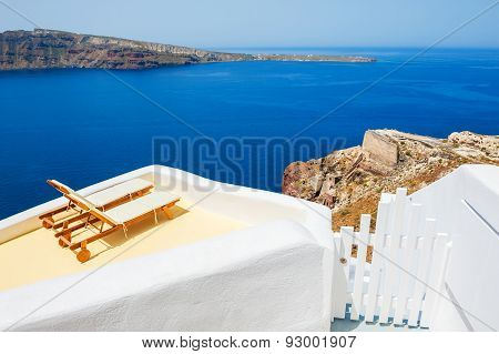 Sunbeds On The Terrace Of A Hotel. Santorini Island, Greece.