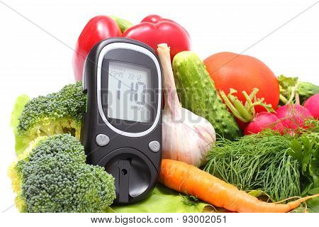 Glucose Meter For Glucose Level And Fresh Vegetables On Wooden Cutting Board