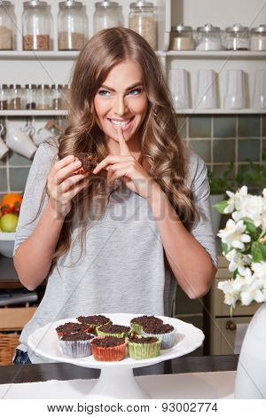 Woman On Diet Eating Sweets In Secret