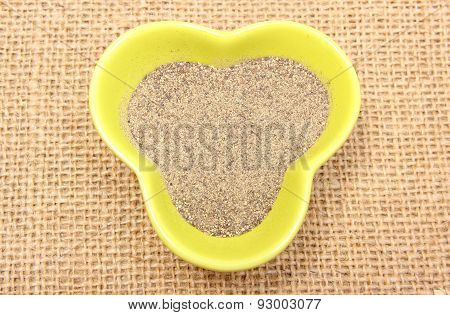 Powdery Pepper In Yellow Bowl On Jute Canvas