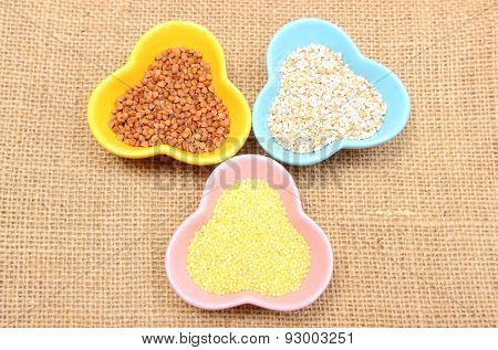 Buckwheat, Barley And Millet Groats In Colorful Bowl