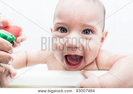 Happy baby boy in bathtub
