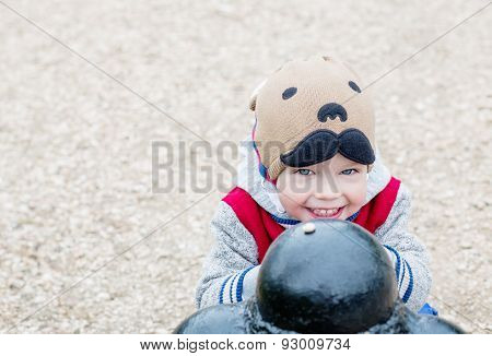 Happy Toddler Boy Playing Outdoors