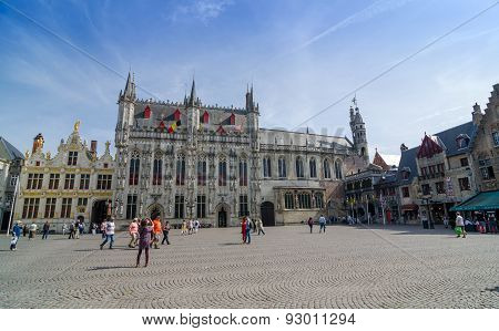 Bruges, Belgium - May 11, 2015: Tourist On Burg Square With City Hall And Basilica Of The Holy Blood