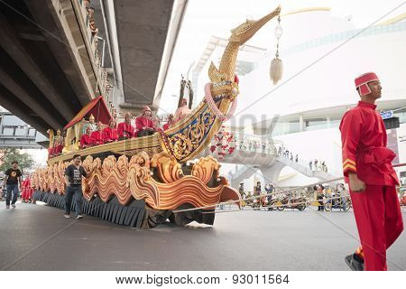 Red man dragging large boat