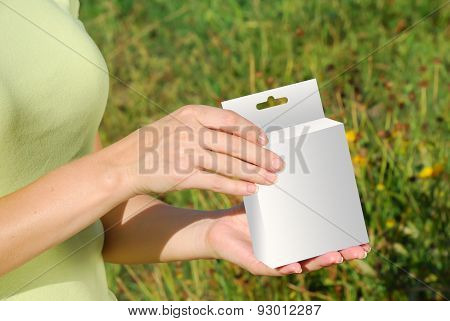 Hands Holding A White Box