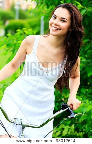 Woman riding bike in a summer park
