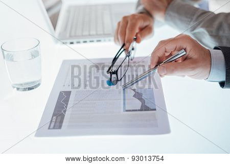 Business Team Examining A Financial Report