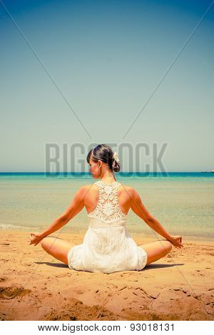 Girl Doing Yoga On A Sandy Beach In Retro Colors