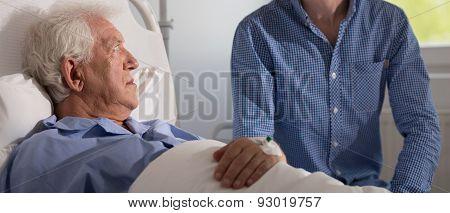 Aged Man Under Drip