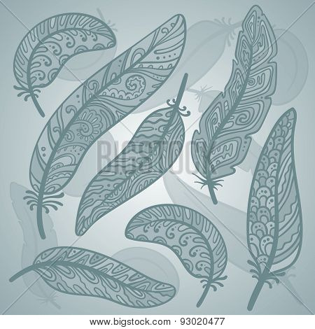 Vector colored feathers set. Bird feathers painted in ornamental patterns