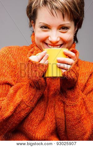 woman with a mug in hands