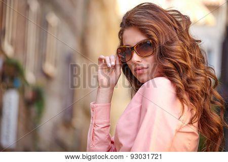 Beautiful woman on the street of a small Italian village