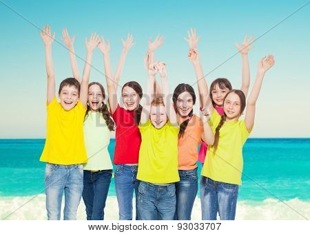 Happy group children at sea. Smiling teen. Friendship boys and girls