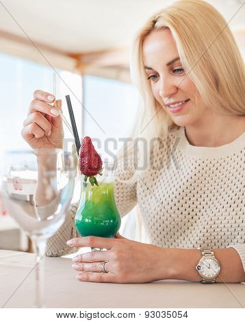 Pretty Woman In Cafe With Bright Tropical Cocktail. Local Focus Image