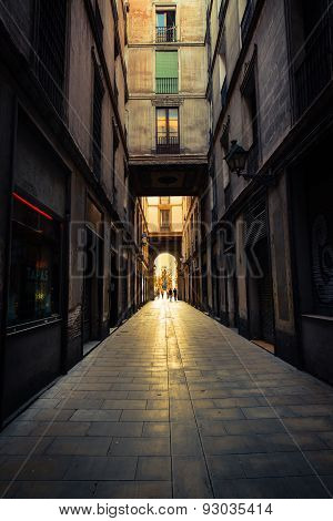 Straight narrow street in Gothic quarter, Barcelona.