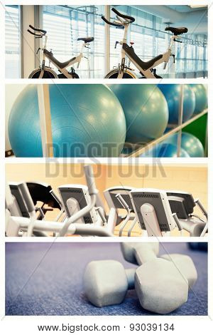 Spin bikes in fitness studio against exercise balls on rack in studio