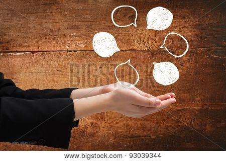 Businesswomans hands presenting against overhead of wooden planks