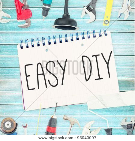 The word easy diy against tools and notepad on wooden background