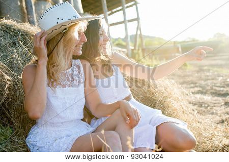 Girlfriends having fun on a farm
