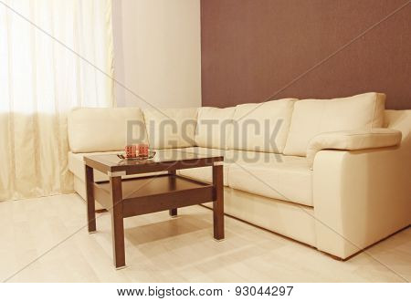 Beige Corner Leather Sofa And Coffee.