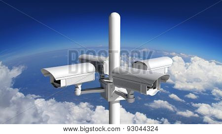 Security surveillance camera with blue sky background