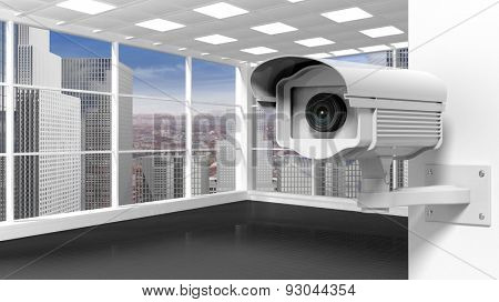 Empty office room with surveillance camera, skyscrapers and city view from the window