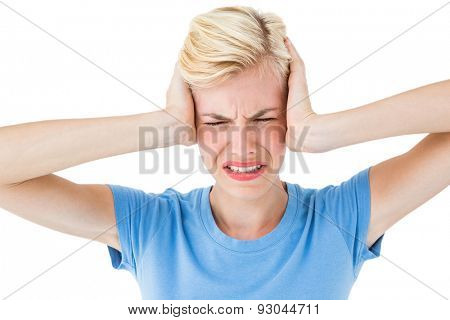 Furious blonde woman holding her head on white background
