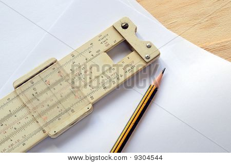 Slide rule and pencil