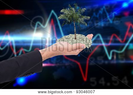 Close up of businessman with empty hand open against stocks and shares on black background