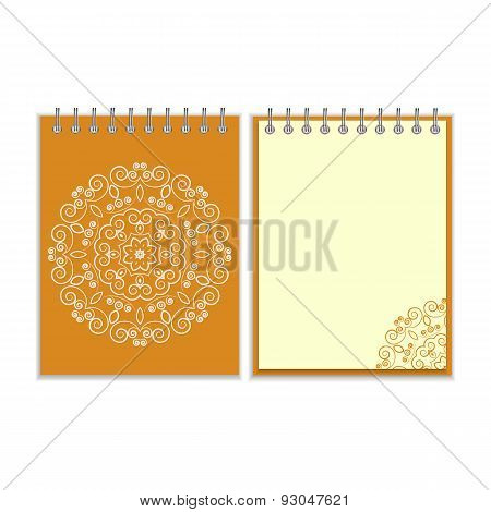 Orange cover notebook with round floral pattern