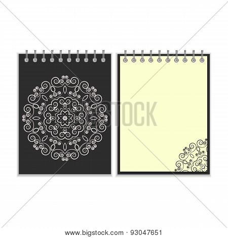 Black cover notebook with round floral pattern