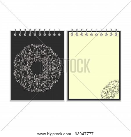 Black cover notebook with round ornate pattern