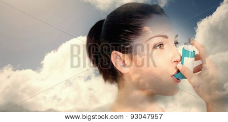 Blue sky with clouds against woman using an asthma inhaler