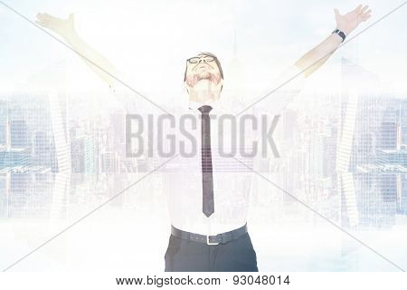 Cheering businessman with his arms raised up against room with large window looking on city