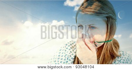 blue sky against female young patient with a mask