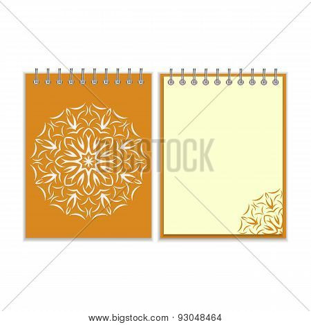 Orange cover notebook with round florwer pattern