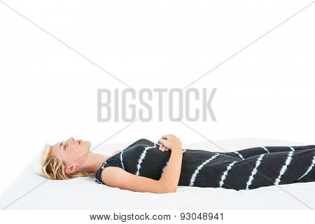 Attractive blonde woman napping on white background