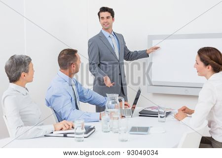 Businessman pointing the white screen in the office