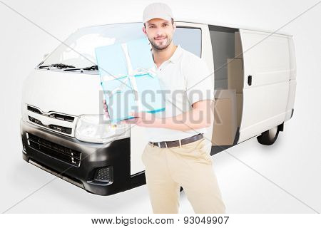 Delivery man with cardboard box against white delivery van