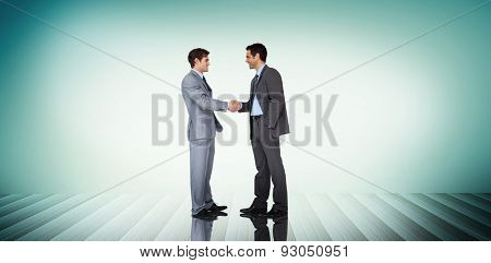 Businessmen shaking hands against blue vignette background